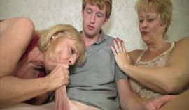 Two horny grannies suck a hard cock
