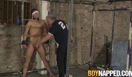 Experienced master works on bound young submissive