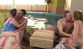 Two grannies and two dudes fuck by the pool