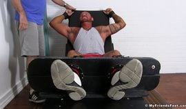 Bodybuilder Michael Roman gets restrained and feet tickled
