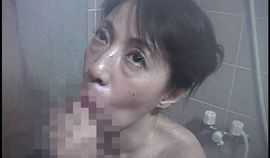 Asian Granny sucking cock in the shower