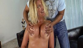 Hot blonde MILF with big boobs gets fucked on the couch