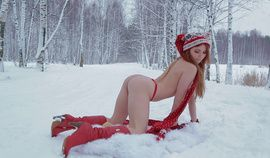 Sexy redhead doll strips in the snow