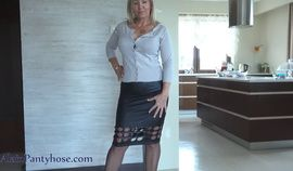 mature in black skirt upskirt and close up pantyhose