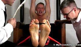 Two pervs tickling tied up jock all over his body in the prison