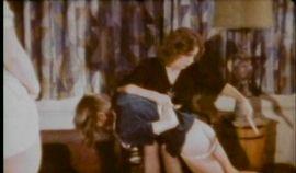 Naughty schoolgirl spanked by her teacher in vintage porn scene