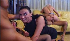 Two guys and three girls in a wild group sex fuck
