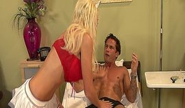 Sexy blonde nurse with big tits having fun with a muscle guy